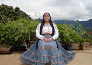 Evelia wearing her traditional dress