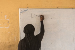 Leadership facilitator writes on classroom board