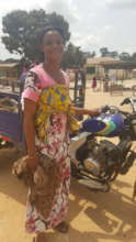 """Akua proudly displays her """"aboboyaa"""" or tricycle"""