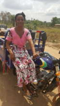 """Akua with her her """"aboboyaa"""" or tricycle"""