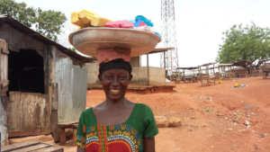 Akosua selling her handmade soaps to the community