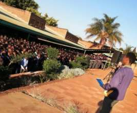 Edzani presents to his school in South Africa