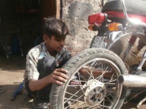 Ali at the car repair workshop