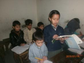 Ali participating in his English class