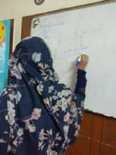 Doing what she loves, solving a maths problem