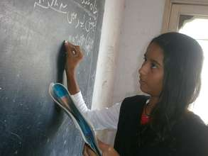 Natalia demonstrating an answer on the board