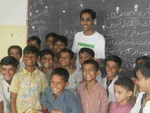 A volunteer visits a Paid to Learn school