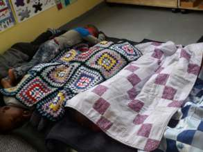 Children sleeping under blankets of joy