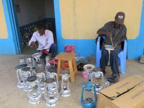 Youths making Mwangabora solar lamps