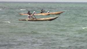 Two young girls on board a local canoe
