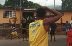 Tombo youth, looting local police station.