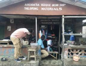 Wudie and his wife Aminata at their new mini shop