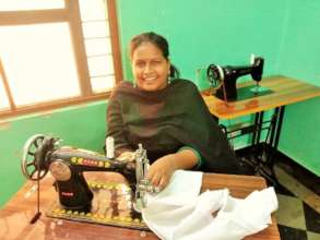 Banu at her sewing machine