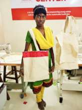 Posing with a cloth bag she made