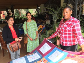 Constance shows her quilt at ICPD25 in Nairobi