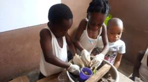 Girls on sculptures through sand casting Project