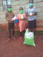 Emma, her brother and sister with their supplies