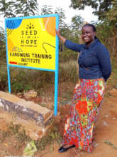 Teacher Jescah showing the new Seed of Hope logo