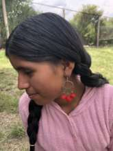 Anita modeling one of the new earring designs