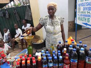 Palm oil seller Adua, new loan client in Nsawam