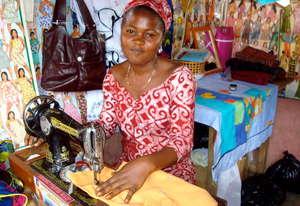 Nsawam loan client, Gifty, sews school uniforms
