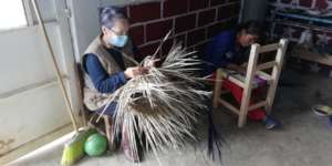 For fun, participants teach Paty how to weave!