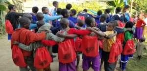 The children receive their school supplies