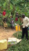 Justus installing the handwashing stations & soap