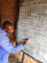 One of our volunteer teaches & the new chalkboard