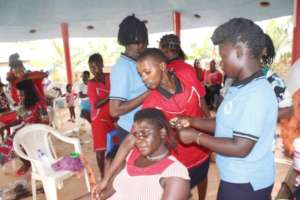 students plaiting hair