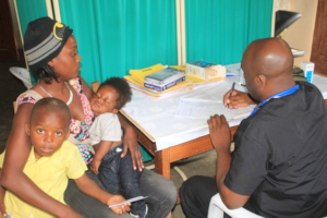 Dr Bernard seeing 2 pediatric patients
