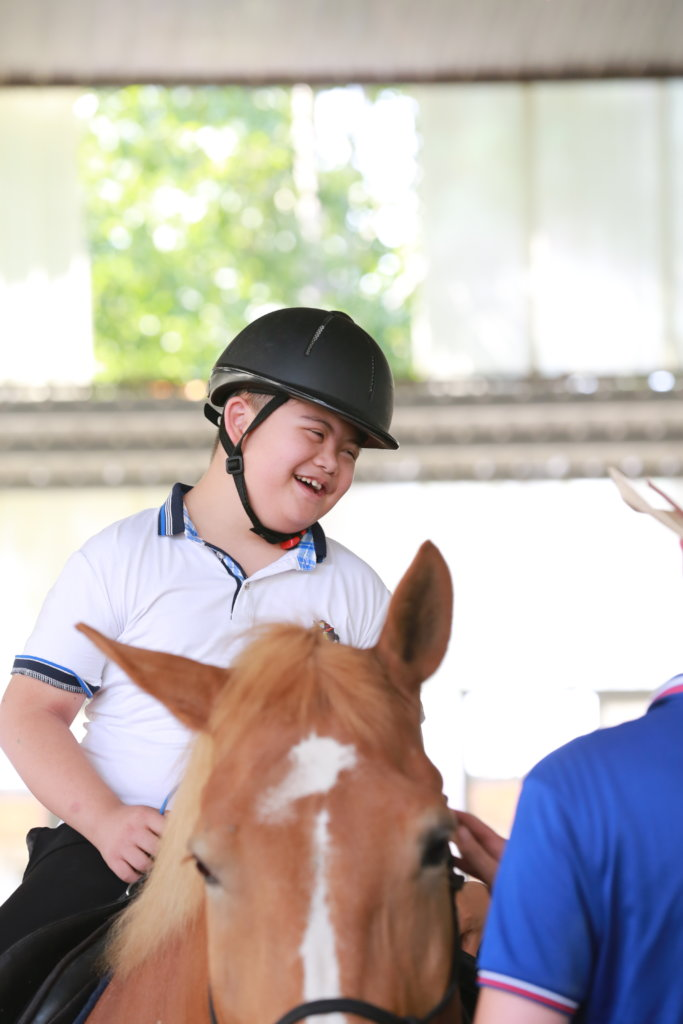 Horse-based therapy for disabled children in China