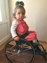 Irinuca in her new wheelchair