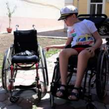 Andrei receives his new wheelchair from Motivation