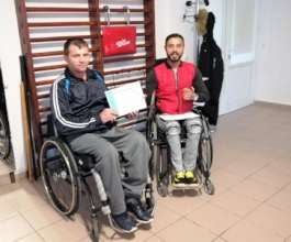 Costel with his independent living trainer, Marian
