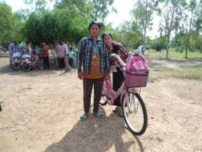Pheap and her mom with Pheap's bike!