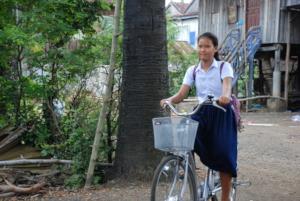 Radha arriving home on her new bike.