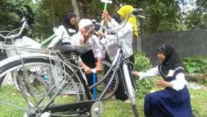Girls pumping bikes