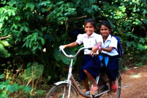 Children of poor families often share their bikes!