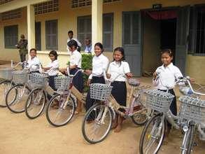 Girls in rural Mondulkiri receive their new bikes