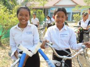 Sreyhang (left) with her new bicycle