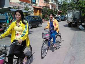Mealea (left) on her Lotus Pedals bike