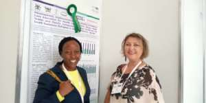 Dr Elizabeth Namukwaya at EAPC with Dr Mhoira Leng