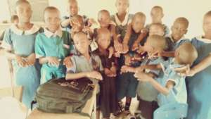 Kids displaying their neatly cut hair and nails