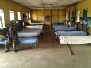 Neatly made beds and hostels