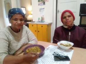 Young and Old enjoy the bread and soup!