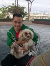 One of our outreach clients and his dog.