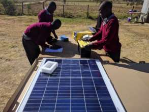 Student team in engineering class working on solar