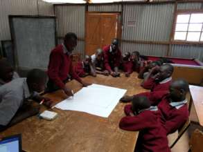 Tumaini students discussion on a design project