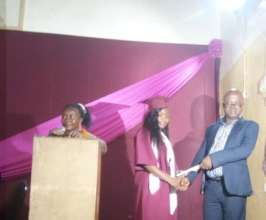 Mbalu receiving her diploma